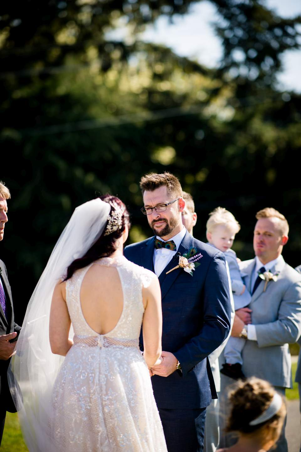 groom saying vows to bride