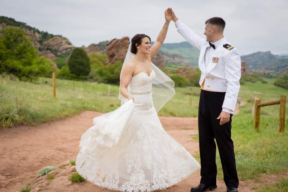 groom twirling bride photo