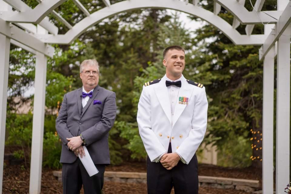 groom watching his bride walk down aisle