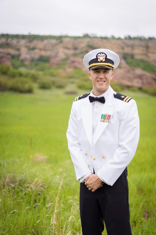groom wearing military dress uniform for wedding