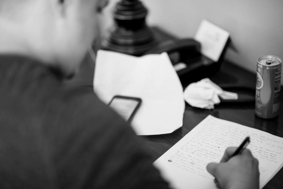 groom writing vows documentary style wedding photography