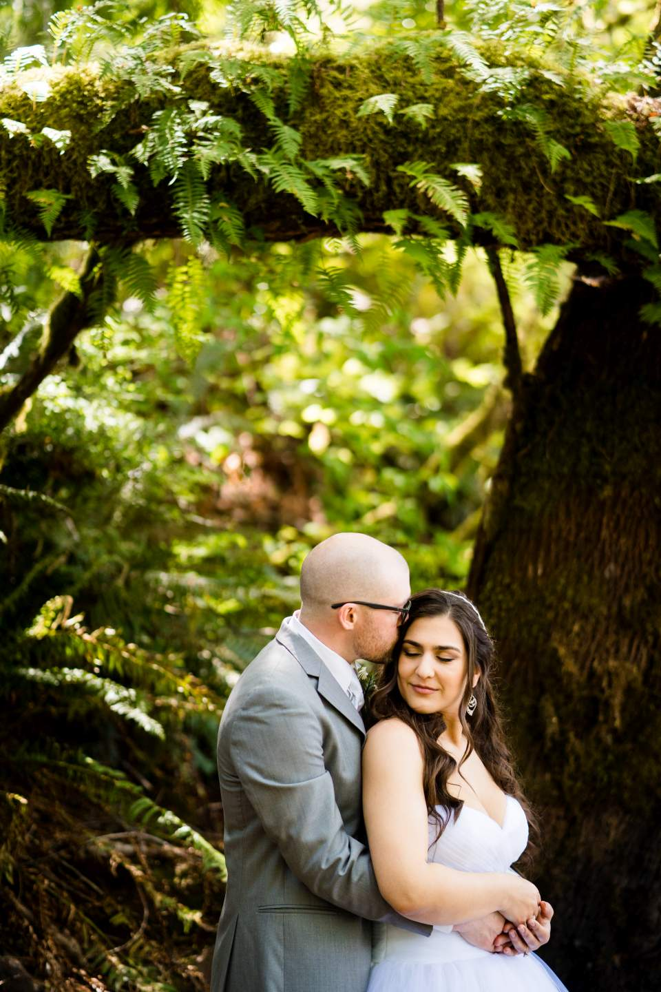 husband and wife portraits wedding day lake quinault lodge