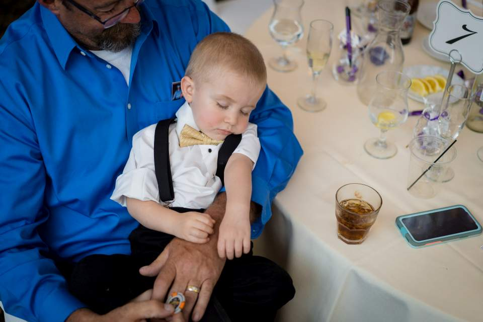 little wedding guest sleeping at table