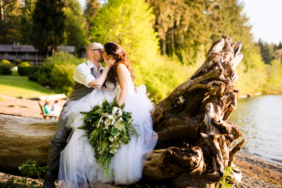 newlyweds sitting on log olypics