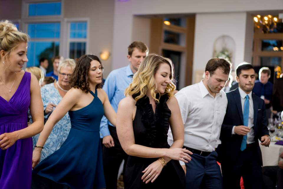 packed dance floor at wedding reception