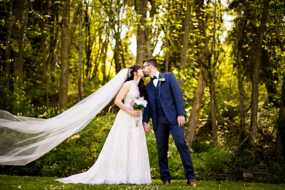 photo of wedding couple kissing