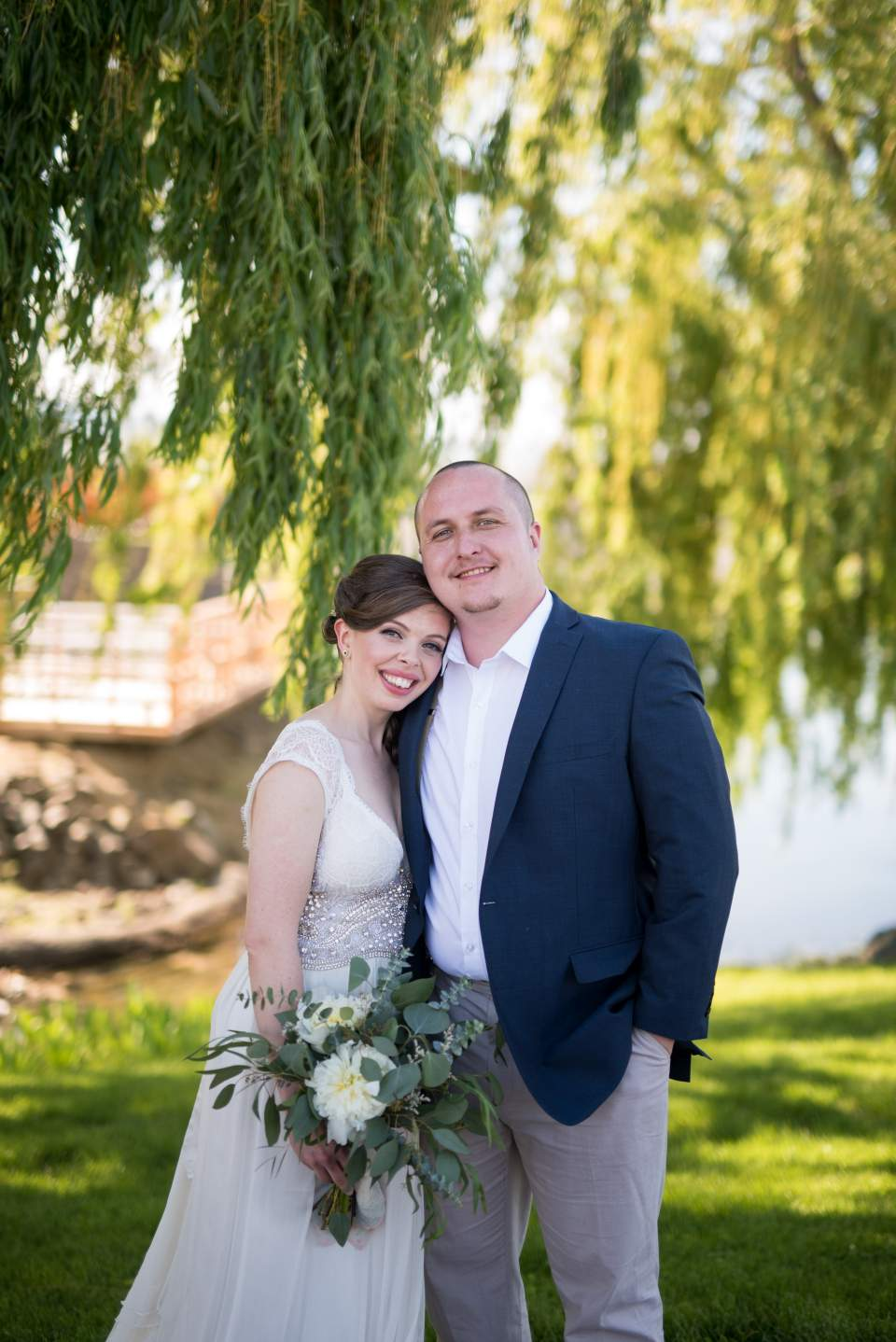 photos of the bride and groom under a willow tree