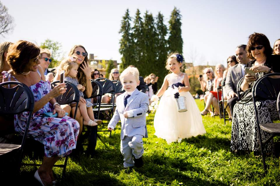 ring bearer and flower girl walk down aisle