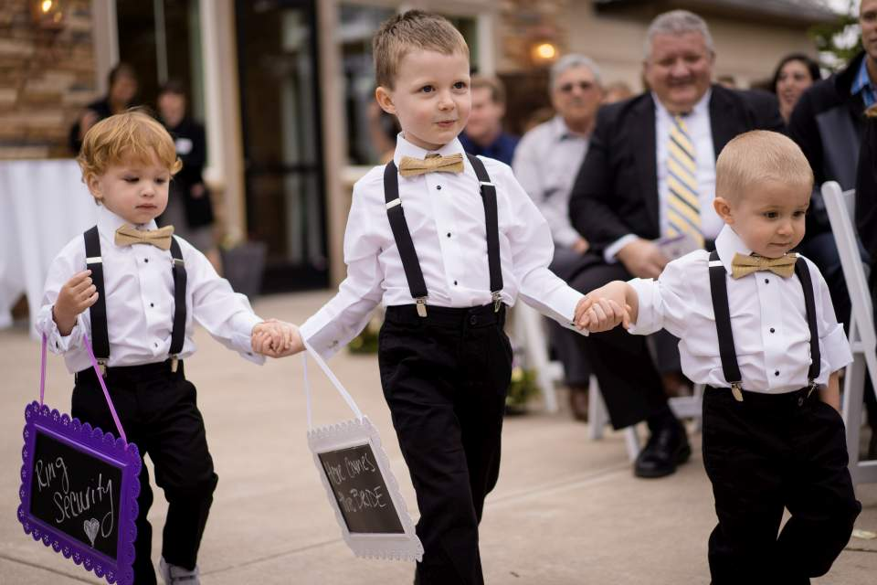 ring bearers walking down aisle