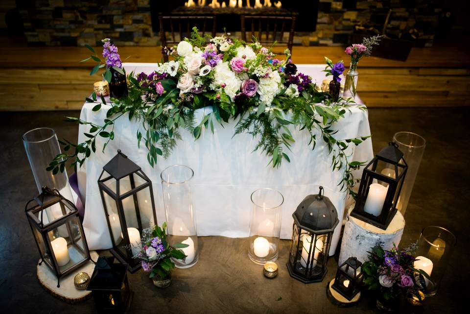 rustic sweetheart table with lanterns