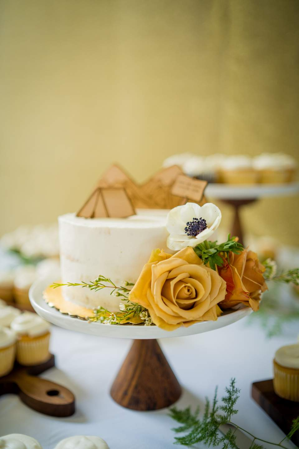 simple cake with tent cake topper