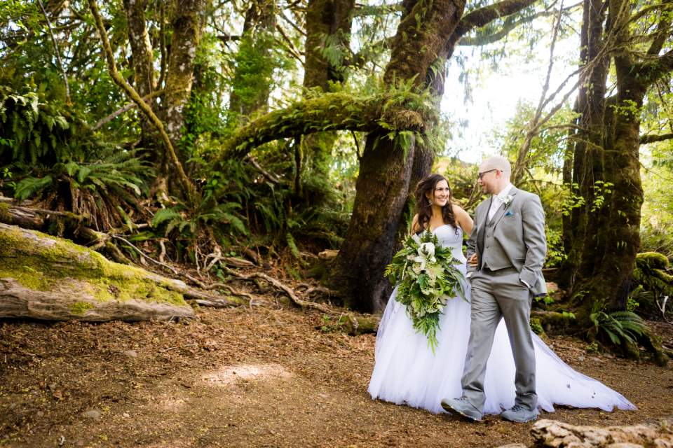 walking through the forest bride and groom olympic national park wedding