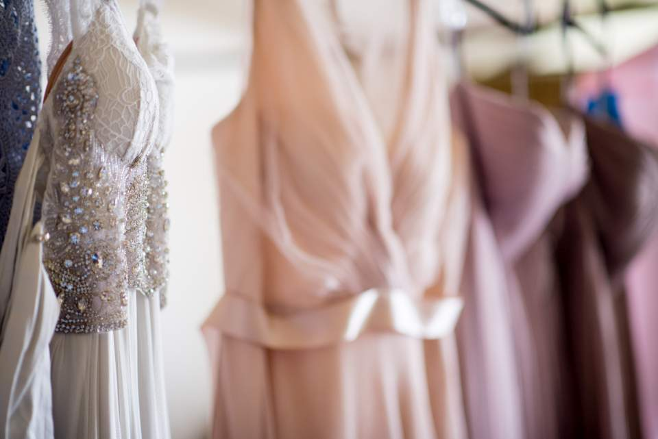 wedding and bridesmaids dresses hanging