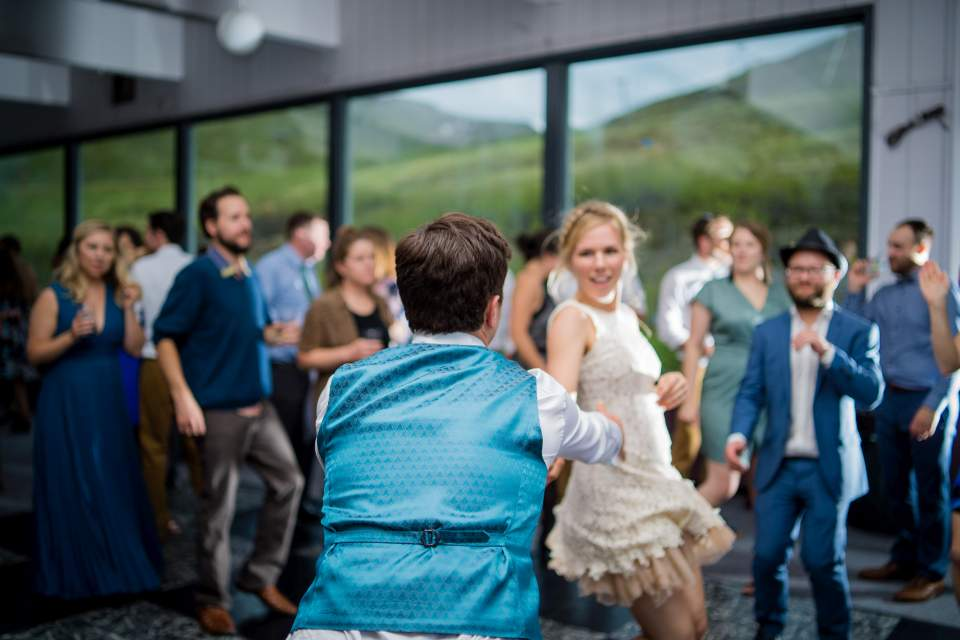 wedding couple dancing to live band at wedding reception