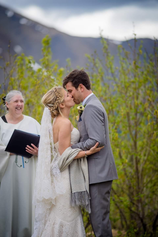 wedding couple first kiss