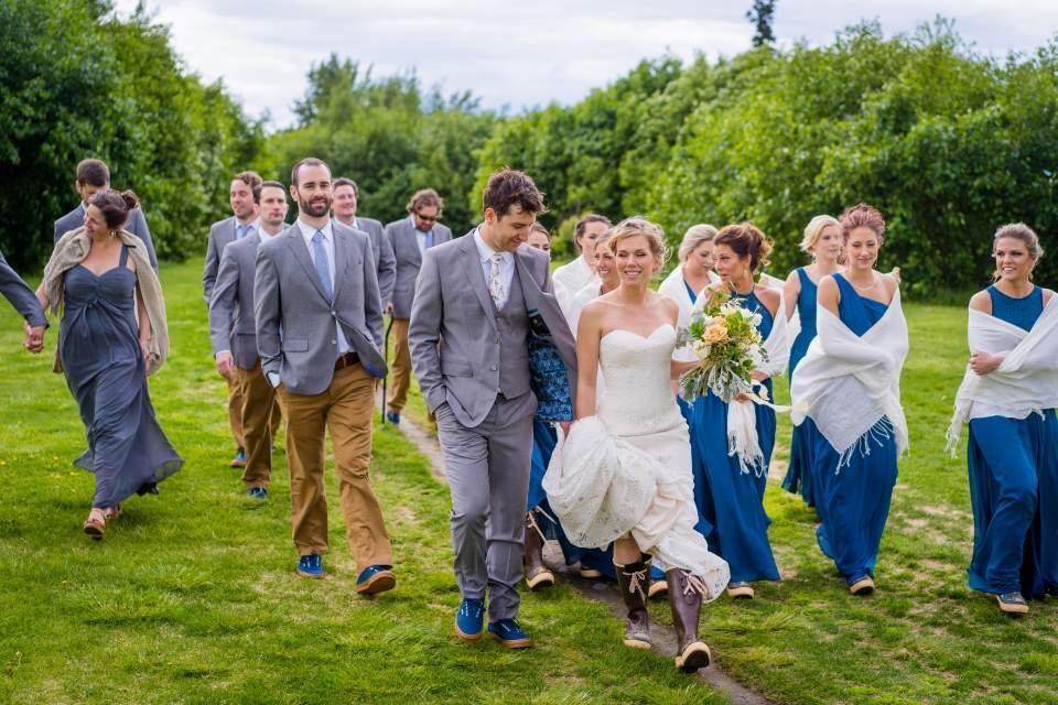 wedding party walking through park