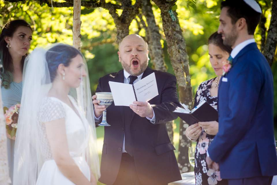 7 blessings being read at jewish wedding