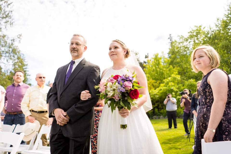 bride and father walking in