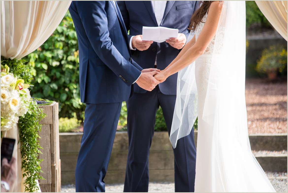 bride and groom holding hands during ceremony 1