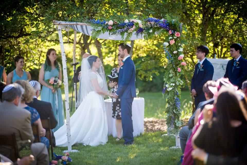 bride and groom under chuppah