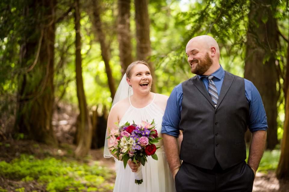 bride and groom walkign through trees kitsap wedding