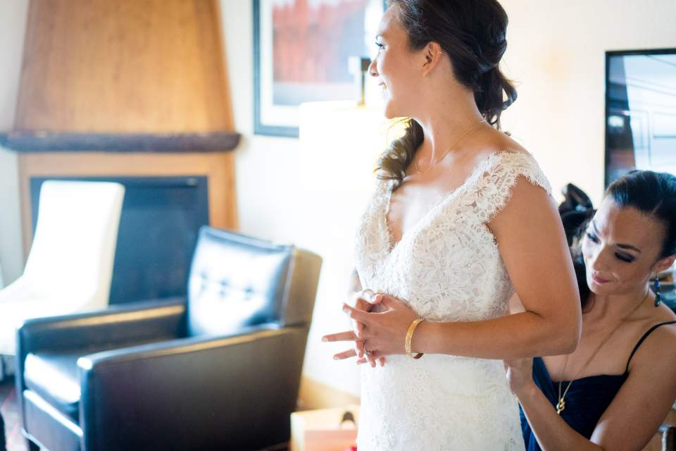 bride getting ready with sister