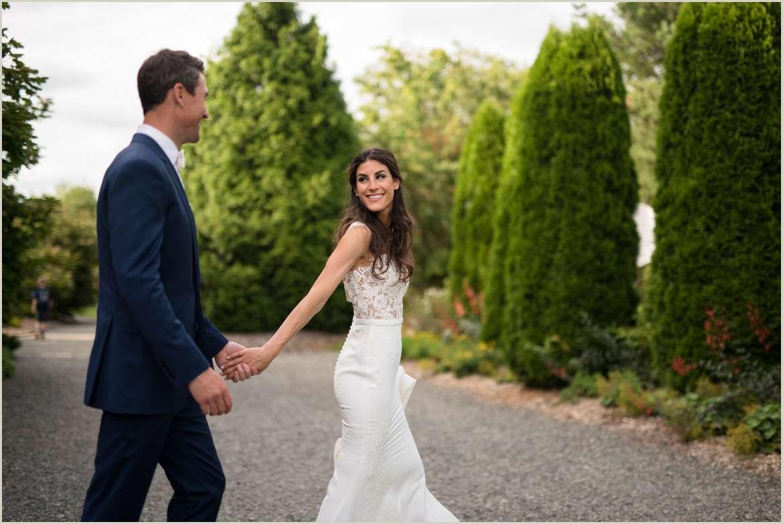 bride leading groom photo 1