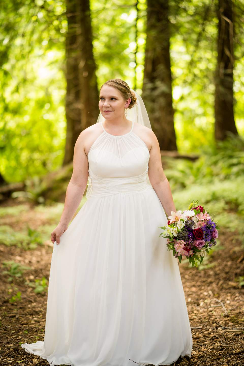 bride standing in ferns kitsap wedding poulsbo