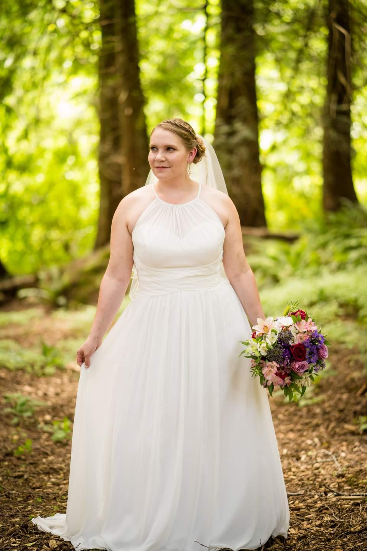 bride standing in ferns kitsap wedding poulsbo