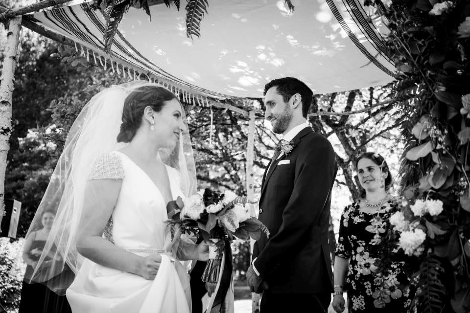 bride walking circles around groom photojournalism at jewish wedding ceremony