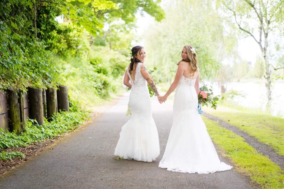 brides walking away seattle wedding photographers