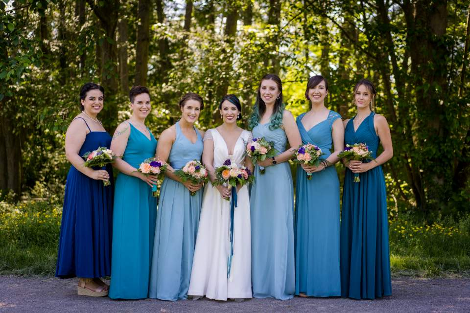 bridesmaids in blue ombre wedding dresses