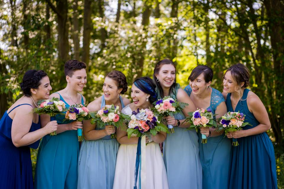 bridesmaids laughing candid wedding photo