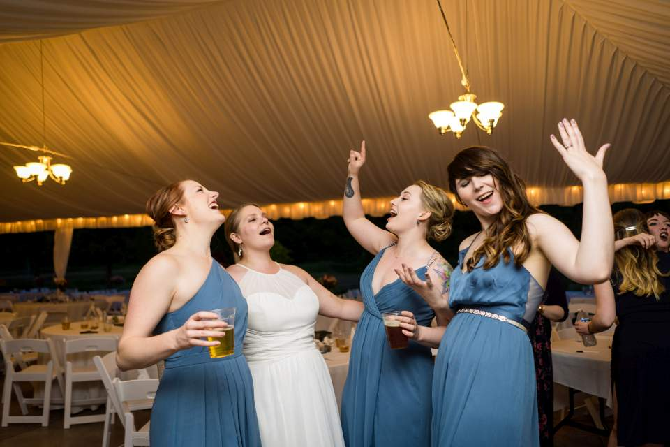 bridesmaids singing along to journey