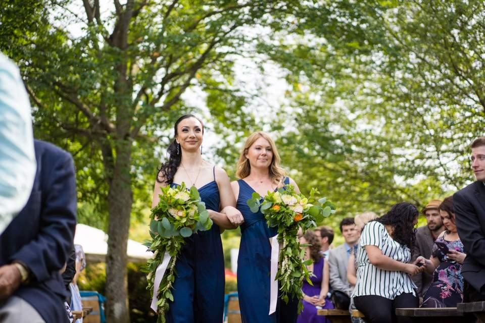 bridesmaids walking in wedding