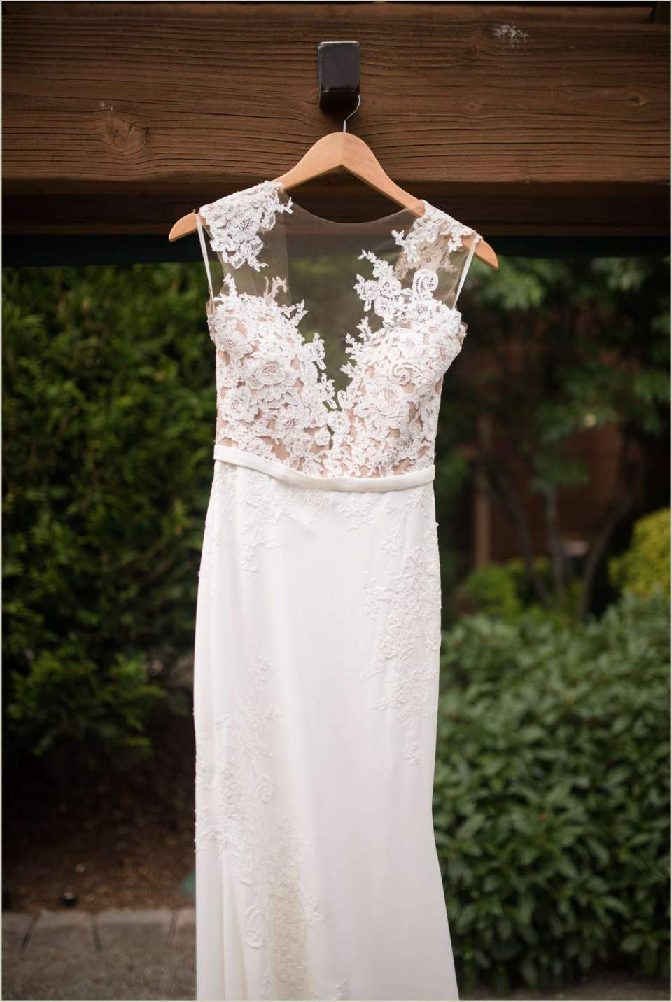 designer wedding dress hanging at willows lodge