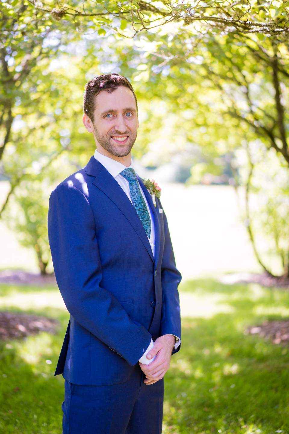 formal photo of groom on wedding day