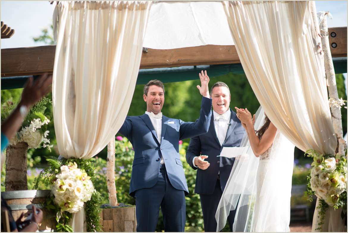 groom cheers after stomping on glass
