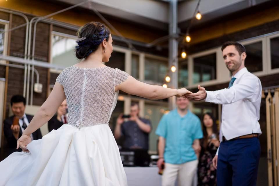 groom spinning bride around on dance floor