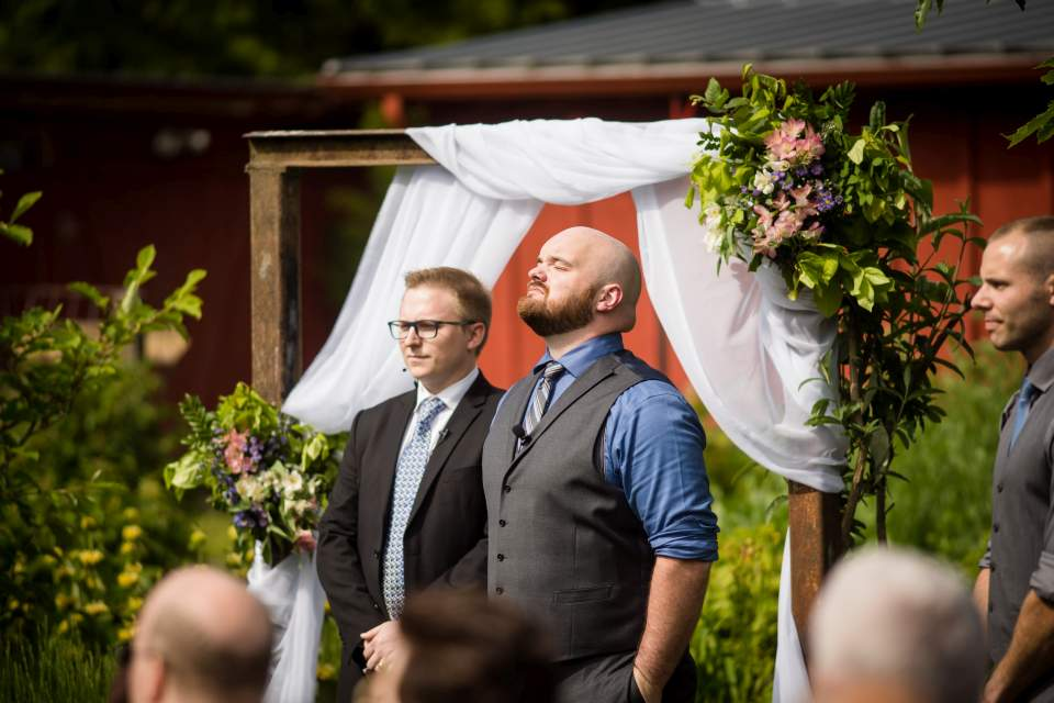 groom waiting at the end of the isle