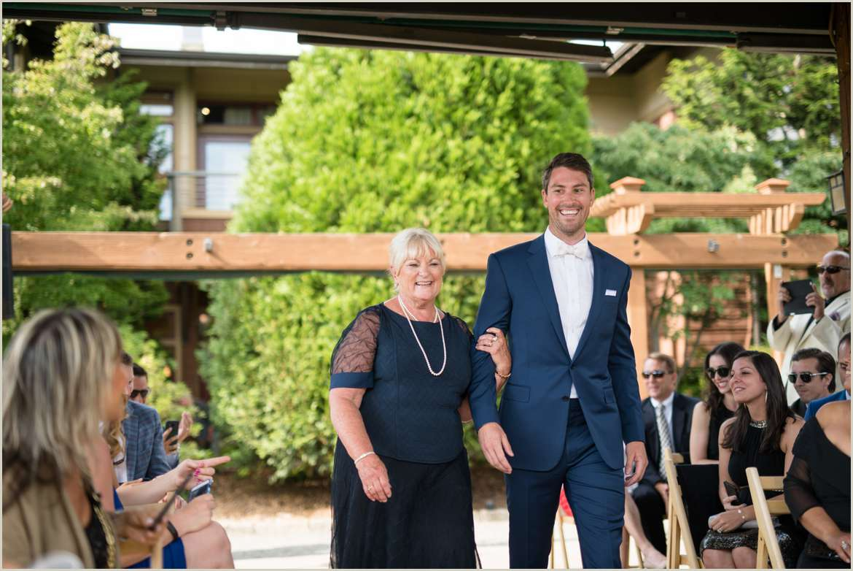 groom walking his mother in