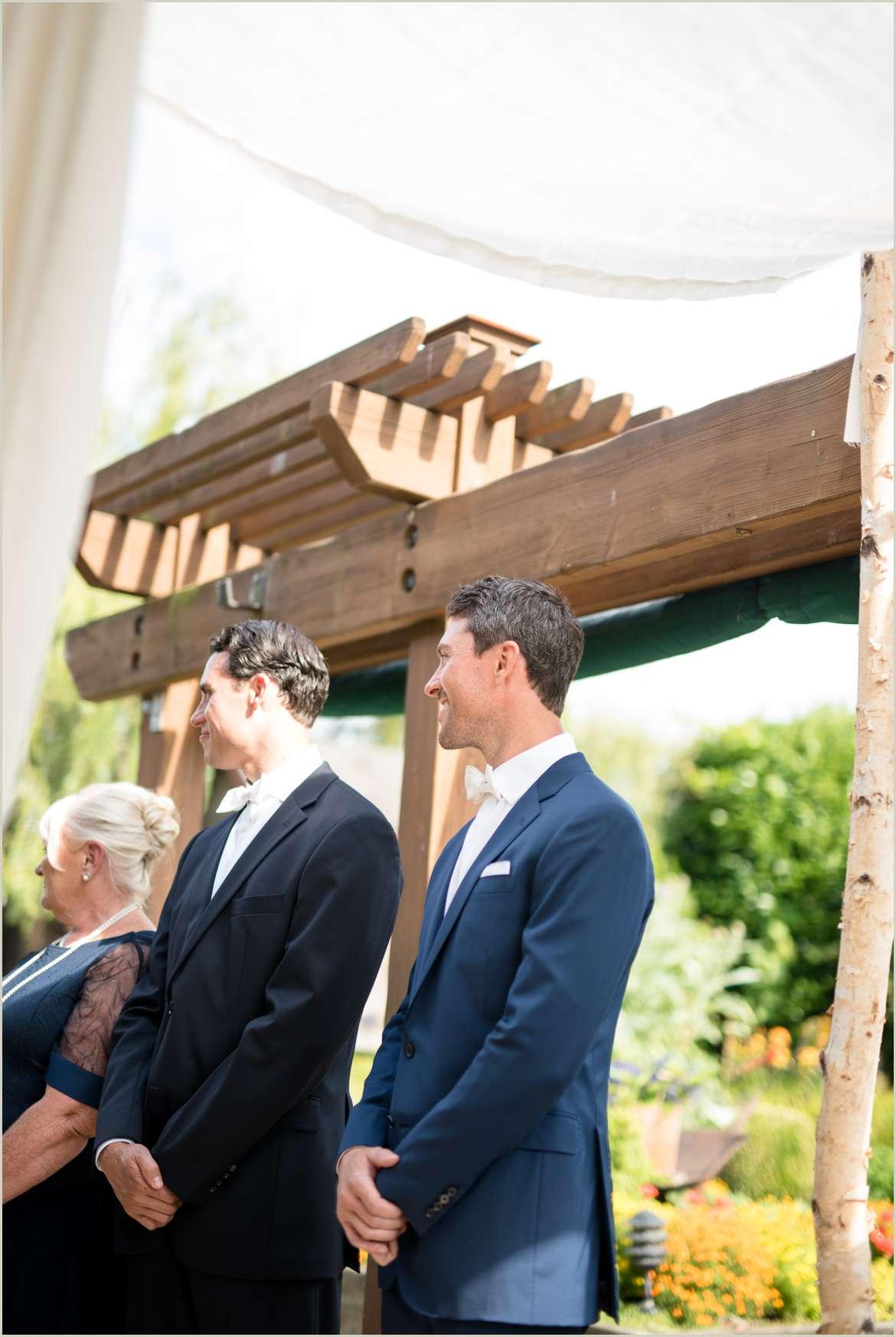 groom watching his bride walk down aisle at willows lodge