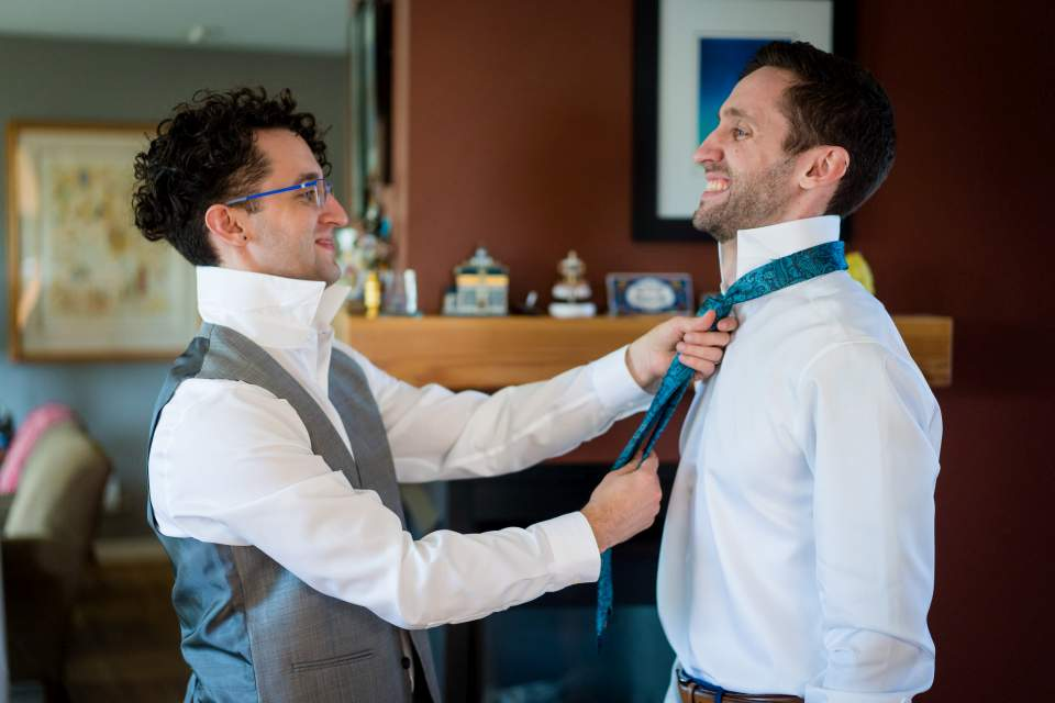 grooms brother helping with tie