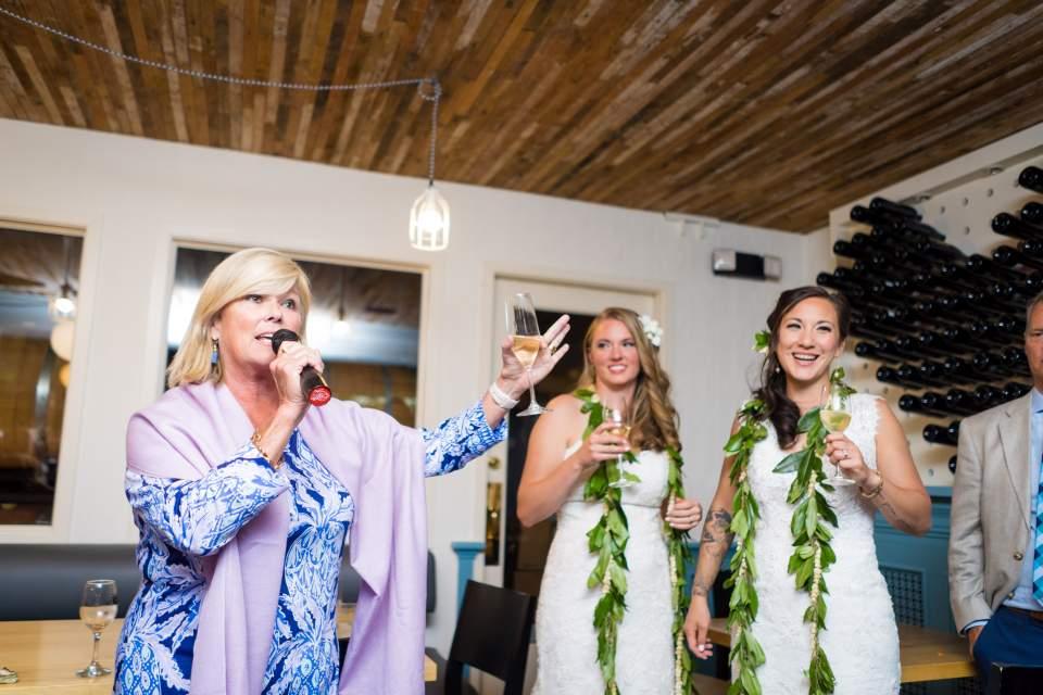 guest toasting wedding reception