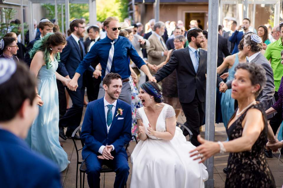 guests dancing around bride and groom