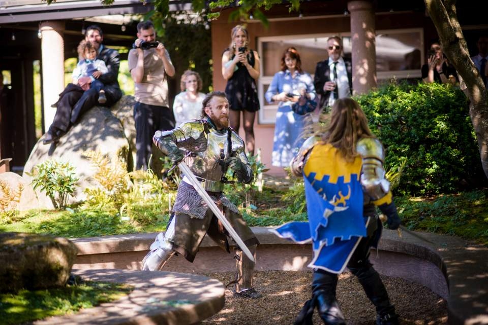 members of the seattle knights have a duel at this quirky wedding at uw
