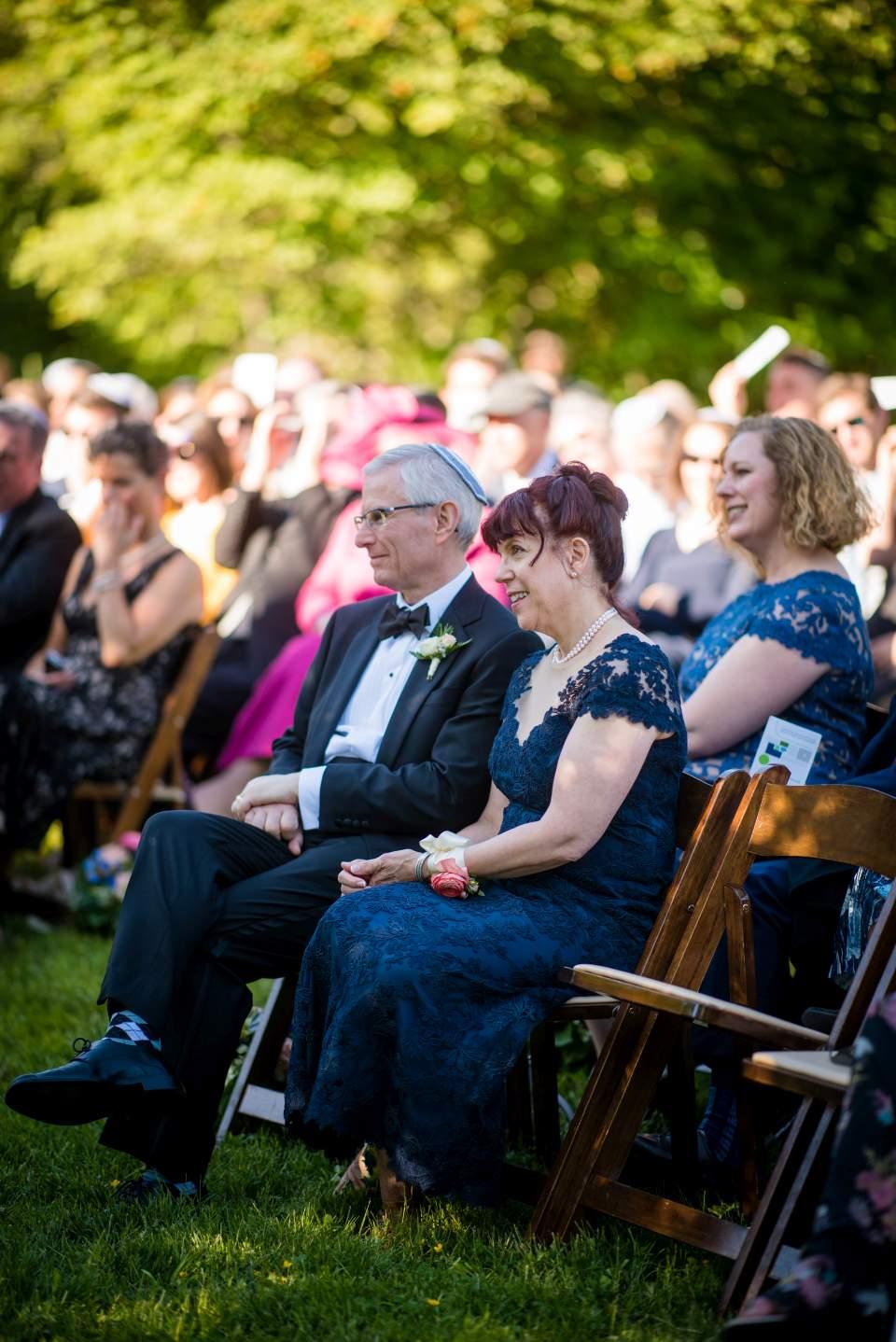 parents watching wedding ceremony