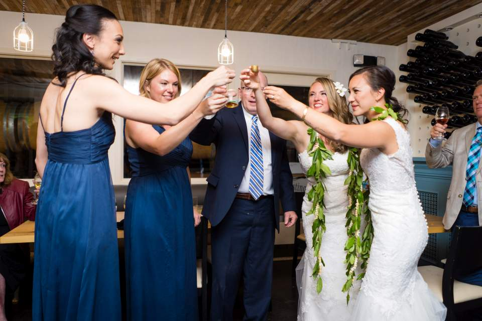 same sex wedding reception toasting candid