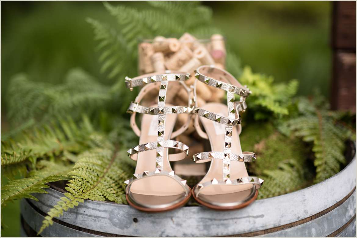 shoes on a wine barrel with ferns