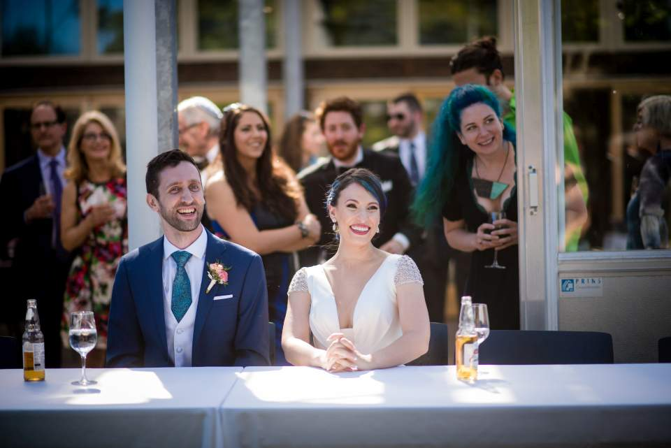 wedding couple watches as two knights duel at wedding